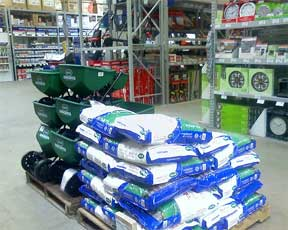 bagged fertilizer and spreaders ready for spring